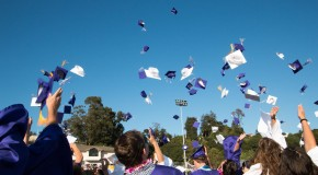 Graduation gowns billow purple together