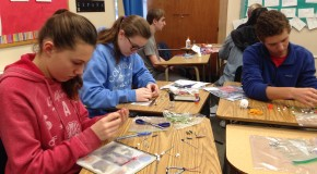 Spanish classes donate time and bracelets to charity